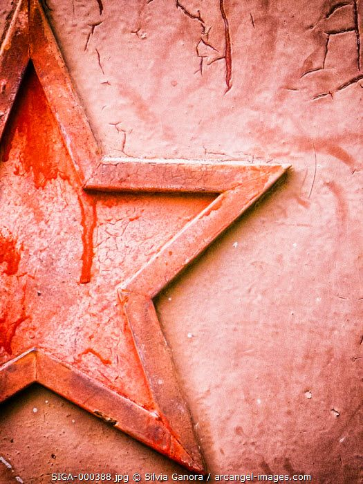 Moody shot of a five pointed star on iron decayed door with paint resembling blood stains - ©Silvia Ganora Photography - All Rights Reserved  #bookcovers #star