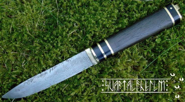 knife decorated with black oak, brass and bufallo horn