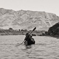 James Cuthbert. Orange River, Namibia. Canoe. Black and white. Free to use. Creative Commons