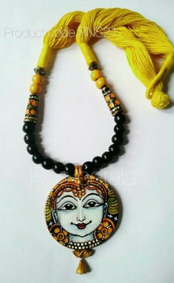 Kerala mural terracotta air dry clay pendant necklace from Ros petals. Kerala mural jewellery.