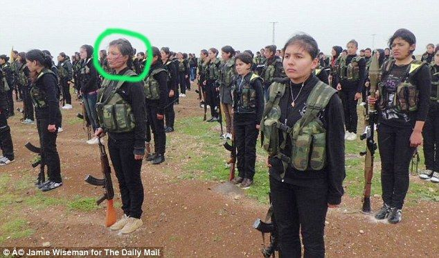 Nesrin, circled, pictured at a ceremony in July when she joined the YPJ fighters to defend...
