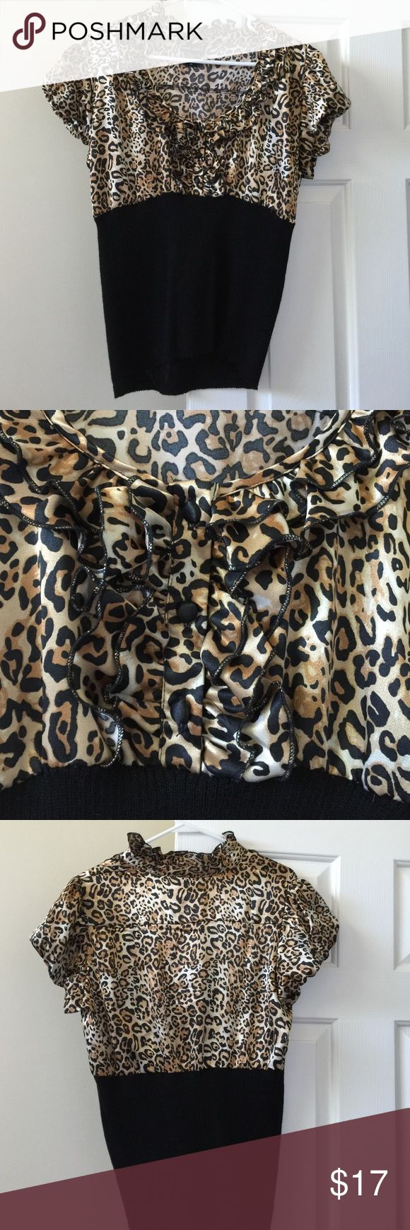 Leopard Top Classic leopard and black top with puckered sleeves and Ruffles and buttons on the chest. Very flattering shirt on, and is a great piece to dress up your outfit. In excellent condition. From Wet Seal. Size XL but fits more like a L. Wet Seal Tops Blouses