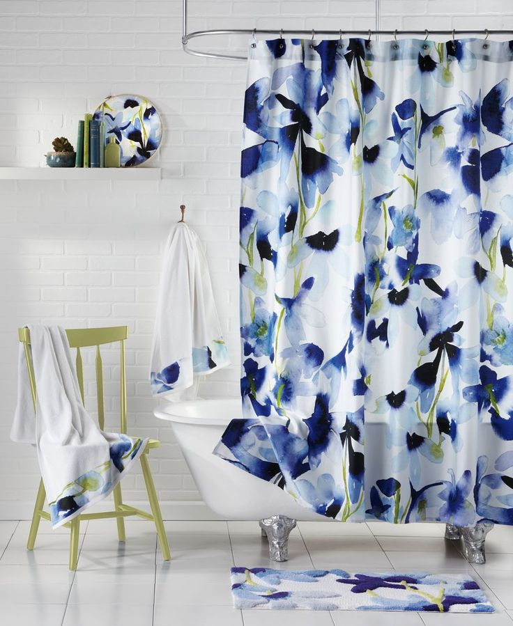 Splashed with a sunny watercolor print of delphinium florals in cool blue and green tones, this Skye shower curtain from bluebellgray will be the focus of your bathroom. | Cotton | Machine washable |