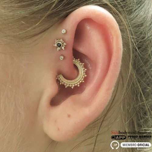"""Daith piercing by Jesus """"Sala"""" Cabanas of Pinpoint Piercing. Jewelry by BVLA."""