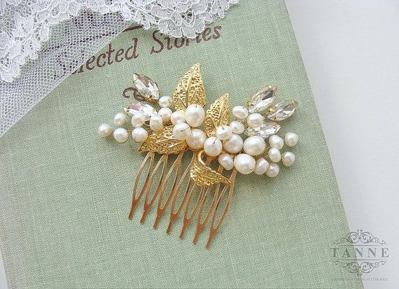 This charming bridal hair comb is richly embellished with genuine ivory freshwater pearls, clear rhinestones and re-purposed brooch with gold