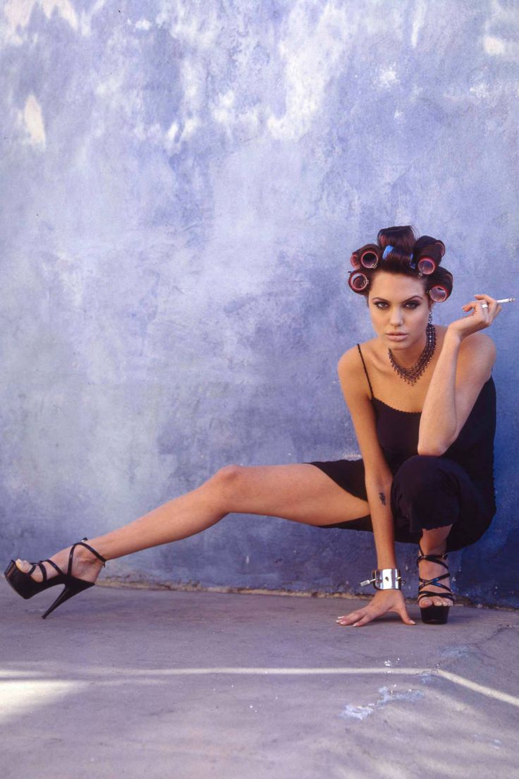 A never-before-seen photoshoot of Angelina Jolie from 1995 has surfaced showing the younger actress posing in a series of sexy (and awkward) photos for the movie Hackers—her first ever film.