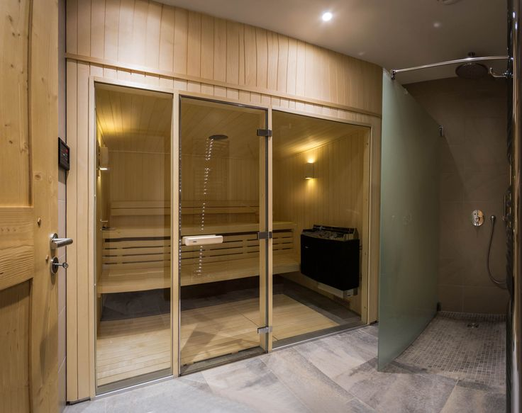 Indoor sauna with adjacent drench shower. Other spa facilities include an outdoor hot-tub and a dedicated massage room