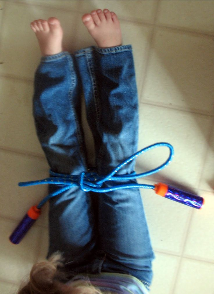 teach a child to tie their shoes using a jump rope so they can see a larger view of what is happening.