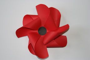 Remembrance Day Poppy Craft - Pinwheel Poppy. Not very original, but as far as crafts go for Remembrance Day, the pickings are slim and this was at least nice looking.