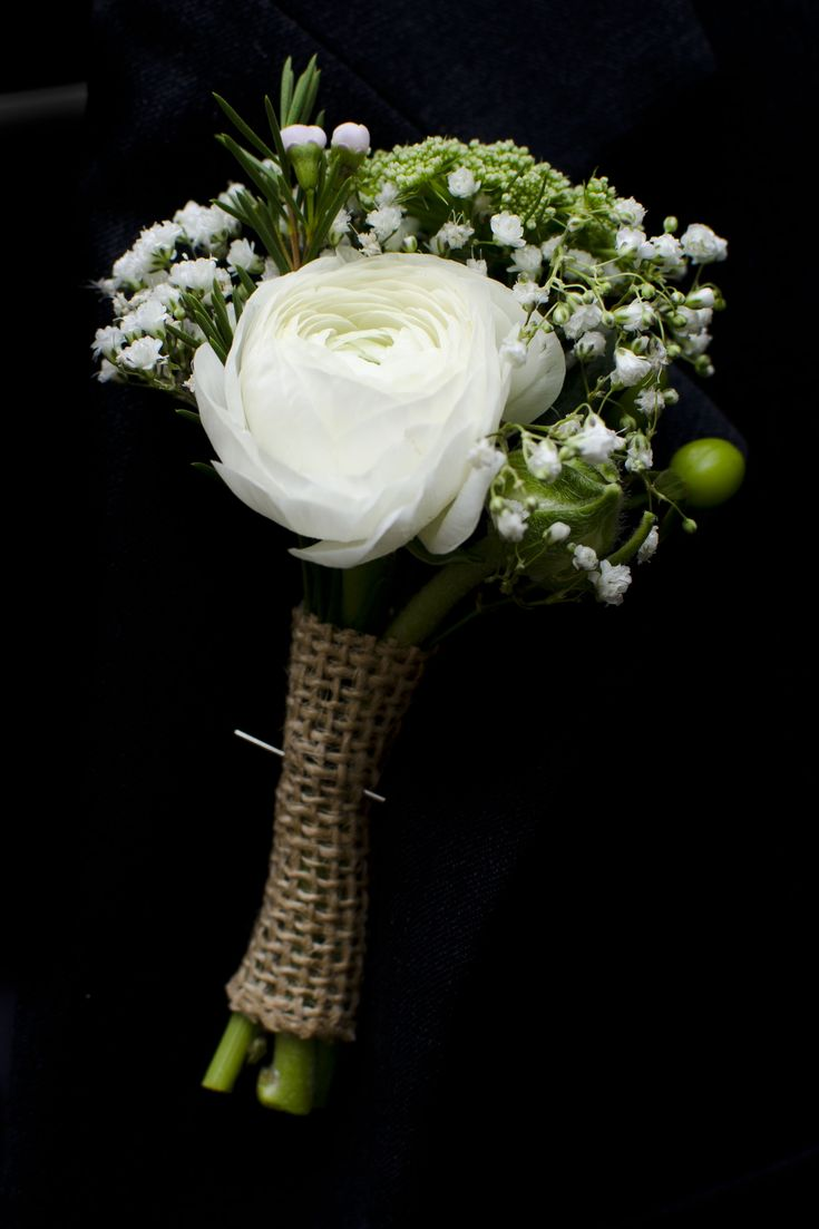 White ranunculus groom or groomsmen boutonniere with baby ...