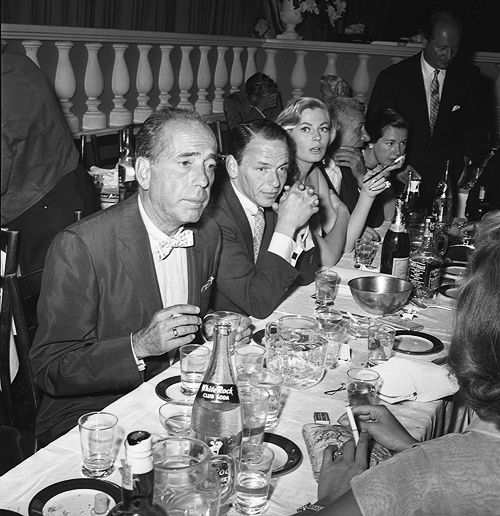 Frank Sinatra with Anita Ekberg, Michael Romanoff, and Humphrey Bogart at Romanoff's restaurant, Aug. 1st 1955