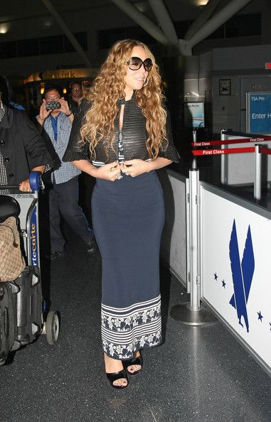 """Mariah Carey Photos - """"American Idol"""" judge Mariah Carey arriving at JFK Airport, New York, wearing a cute cropped leather jacket. - Mariah Carey Wears Leather to the Airport"""