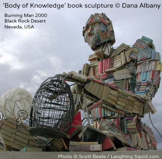 "BODY of KNOWLEDGE © Dana Albany (Book Sculptor) @ BURNING MAN 2000,  Black Rock Desert, NEVADA, USA.  ""A large-scale sculpture of the human body, entirely composed of out-date textbooks and discarded library books"""