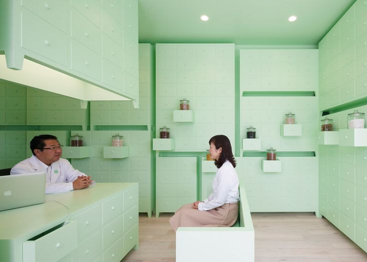 Mint Green Cabinets Are Stacked Up In A Japanese Acupuncture Clinic