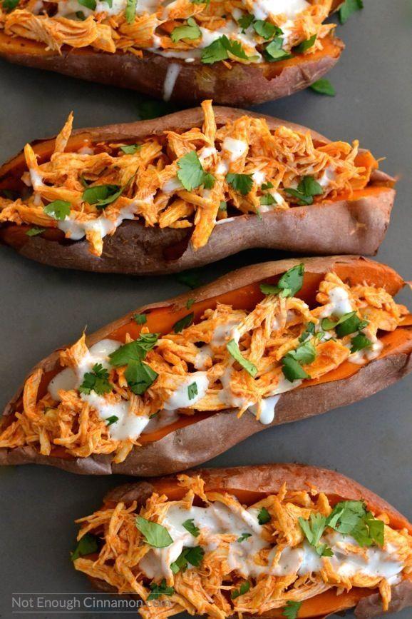 Baked sweet potatoes loaded with buffalo sauce shredded chicken + skinny blue…
