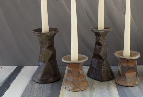 Clay candlesticks by Catherine White. They are so primal and earthy.