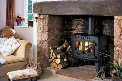 I like the look of the wood stove with a stone surround area.