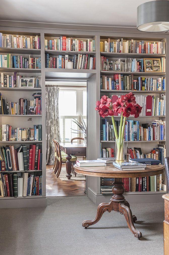 Floor to ceiling, wraparound bookcase.