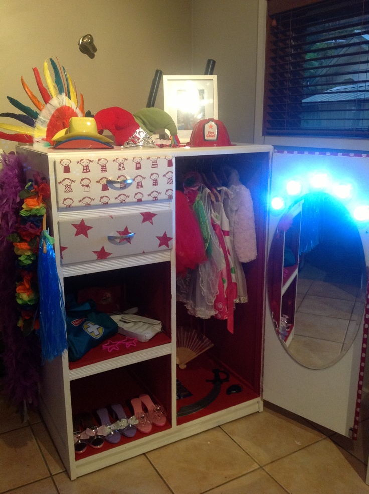 Upcycled cupboard into dress up cupboard for our kids for Xmas. Ikea press lights, fabric covered draws, ikea mirror ( draws used for dolls' house)
