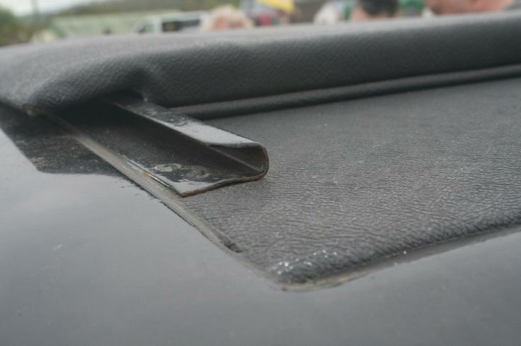 Close up of rear roof fabric and sun roof slider rail