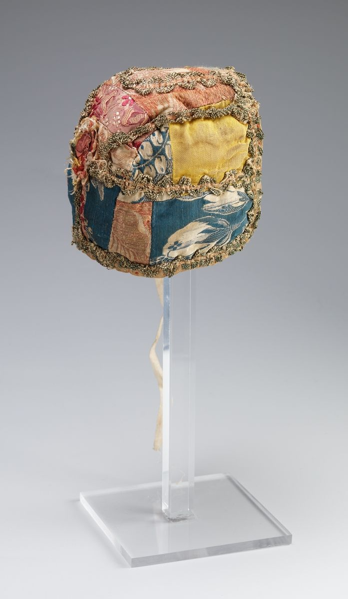 Child's cap, Norway, second half 18th century. Different silk brocades, metall lace decoration, linen lining.