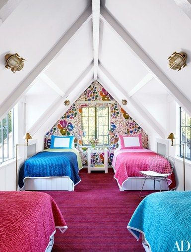 Designer David Netto enlivened the children's bedroom and play area with Josef Frank florals by Svenskt Tenn, a Harry Bertoia wire chair from Design Within Reach, and carpet by Patterson Flynn Martin | archdigest.com