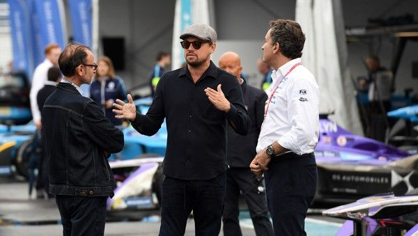 Leonardo DiCaprio Photos - In this handout photo provided by Formula E, Leonardo DiCaprio tours the garages on the eve of this weekend's inaugural Formula E New York City ePrix on July 14, 2017 in the Brooklyn borough of New York City. This historic ePrix marks the first time that motor-sport racing has ever come to the five boroughs, something only possible because of Formula E's quiet, electric cars and commitment to sustainability.