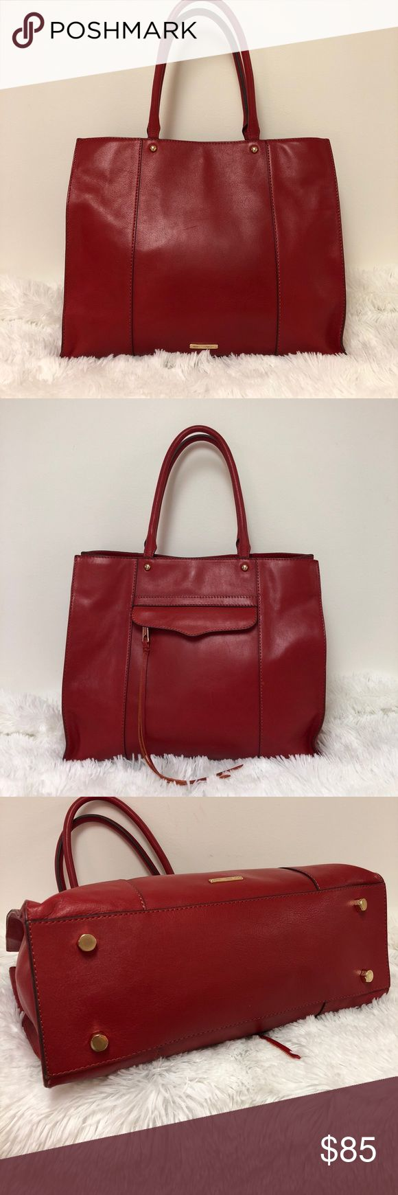 Rebecca Minkoff MAB Satchel Just in time for the holidays! 🎄This beautiful red Rebecca Minkoff satchel is ready and waiting to accompany you on all your Christmas outings. It's big enough to take shopping and classy enough for any Christmas party. It would even make a perfect Christmas gift fo just the right person. It is in very good condition and comes with several extra tassels. See pics for slight corner flaws. Interior is in excellent condition. Overall this is a very well maintained…