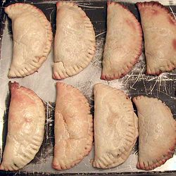 Three Guys From Miami's Chicken and Cheese Empanadas recipe- These are so yummy! I make the baked chicken and cheese recipe. Shhh.. sometimes I add raisins b/c I love a sweet/savory combo.