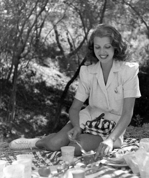 Rita Hayworth during picnic on the grass in the Hollywood Hills. June 1940 Photographer-Peter Stackpole