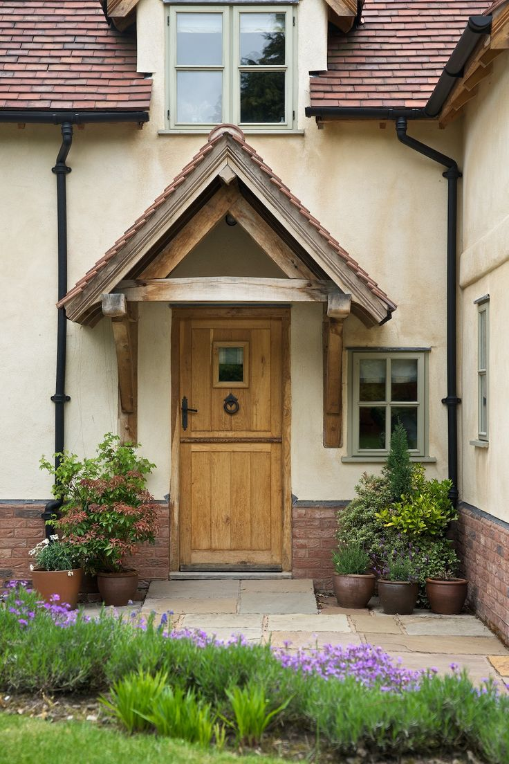 Solid oak stable door with porch canopy and 'From The Anvil' Ring Door Knocker and Tudor Style Lever Handle - Looks great on @border_oak homes.
