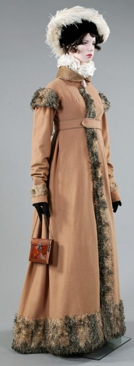 Aglae. From the exhibition Napoleon and the Empire of Fashion. Lancaster-Barreto collection.Coat: Camel wool in natural colour. Silk organza collar, pipping and buttons. Pluche de some, imitating fur, France, circa 1808. Mechlin collar lace. Great example of the influence of Napoleons peninsular war, the troubadour painting and the romanticism.  Manches a la espagnole Cameo: seashell, enamel, gold. France, first quart of the XIX century. Bag: Marrocain ...