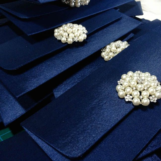 luxury navy blue wedding envelope with pearl brooch