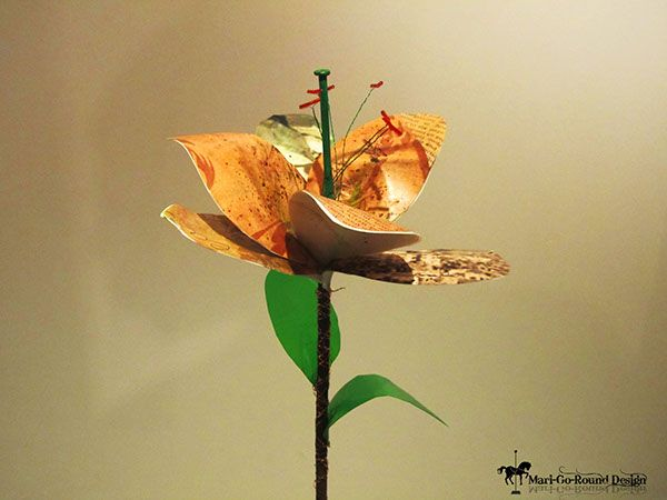 """Petals of Hope Exhibition. Recycled Art. As designers, our main focus is the act of problem solving. The concepts that came to front were """"rethink, re-use, recycle"""". Art by Mari Basson"""