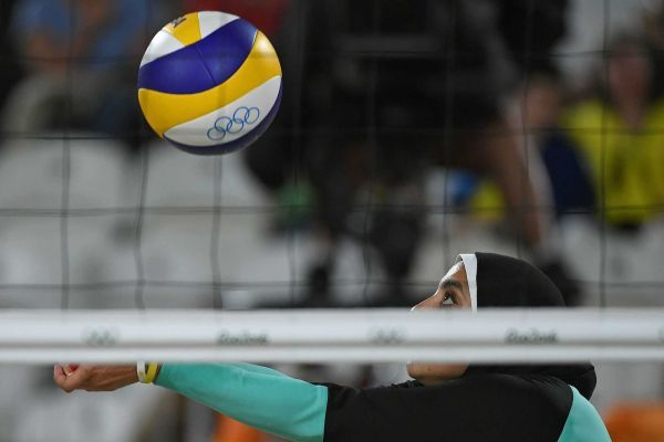 Egypt's Doaa Elghobashy sets the ball during the women's beach volleyball qualifying match between Germany and Egypt at the Beach Volley Arena in Rio de Janeiro on August 7, 2016, for the Rio 2016 Olympic Games.
