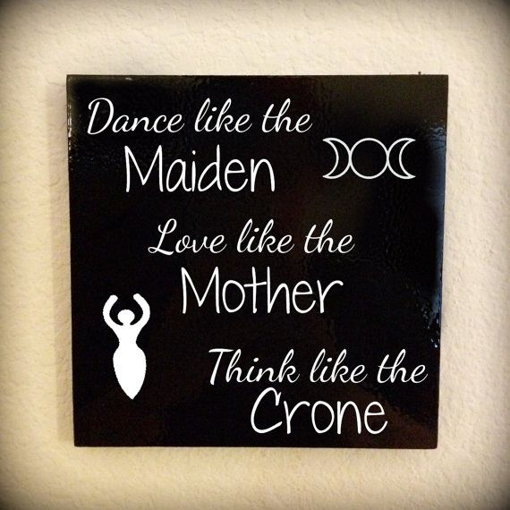 "Remember the triple goddess every day. Hang this lovely Wiccan art prominently in your home.  The wooden piece is 6"" X 6"" and painted a glossy black. The commercial quality vinyl lettering is a matte white, causing the image to stand out beautifully.  Other phrases are available as well in my shop so feel free to browse around!"