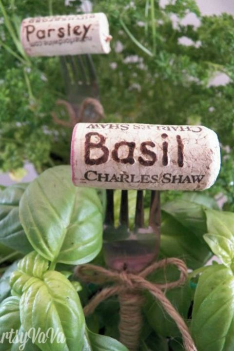 Keep your flourishing herb garden organized with DIY plant markers made from old forks and labeled corks. Genius, no? Get the instructions at redbookmag.com and more holiday decorating ideas.