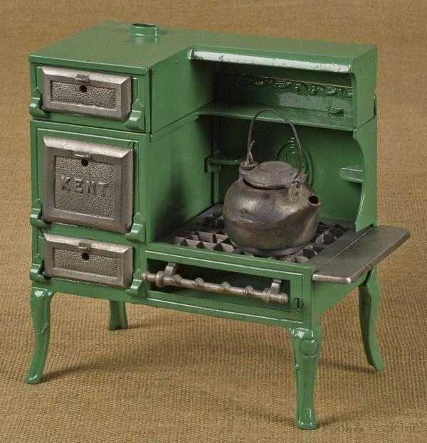 "Kenton cast iron Kent toy gas stove with a steel tea kettle, 9 1/2"" h., 9 3/4"" w. Estimated auction value: $150 - $250"