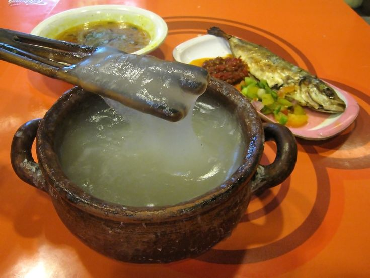 Papeda (sago congee), Kuah Kuning (yelow soup) and Ikan Tude Bakar (grilled fish) with Dabu-dabu and Rica sambal. The Eastern Indonesian meal; Papeda, the staple food of Eastern Indonesia have a glue-like consistency and texture.