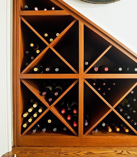 Wine storage under the stairs and refridgerator w/ wood dor over fridge
