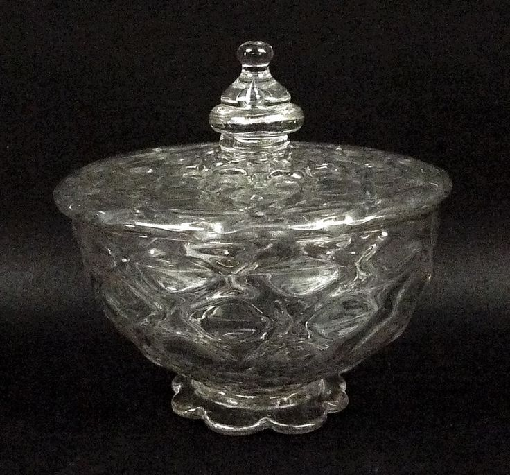 Batemans Auctioneers:A nip diamond waies glass sweetmeat dish and cover, circa 1680-1710, manner of George Ravenscroft, with Venetian inspired honeycomb decoration, the knop with a single tear drop, raised on a petalled foot, 13.5 by 13.5cm.