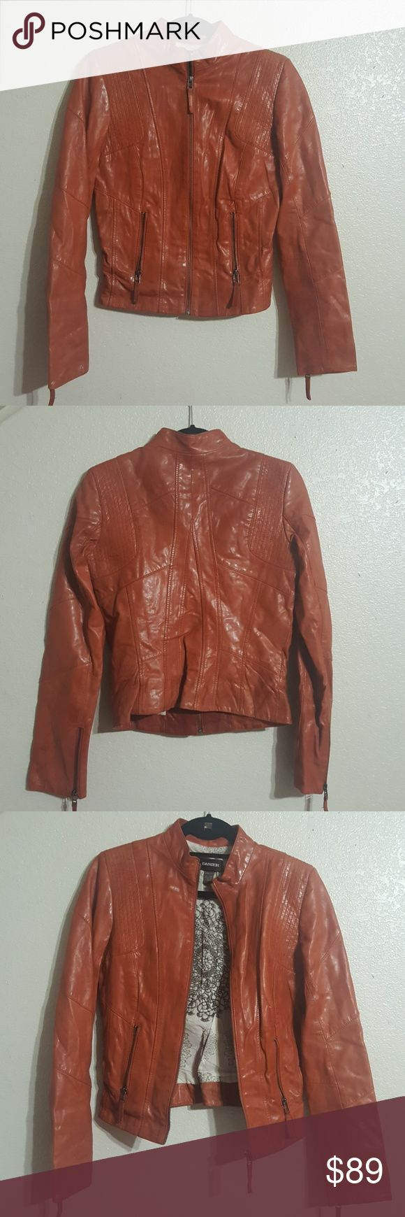 "DANIER MOTORCYCLE LEATHER JACKET Beautiful and sylish Danier brown leather jacket.  Zipper closure with sleeves zipper detail and two small front pockets.  Pre-owned in great condition, beautiful natural leather patina that gives character and personality.  Size XS, bust 17"", waist 15"", length 23"". DANIER Jackets & Coats"