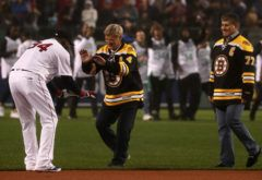 Boston, MA - 10/01/2016 - Bruins greats Bobby Orr and Ray Bourque joined members of the three sports teams, Patriots and Celtics to honor Boston Red Sox designated hitter David Ortiz (34) befoe the game. The Boston Red Sox take on the Toronto Blue Jays in Game 2 of a 3 game series at Fenway Park. - (Barry Chin/Globe Staff), Section: Sports, Reporter: Peter Abraham, Topic: 02Sox-Jays, LOID:8.3.170500066.