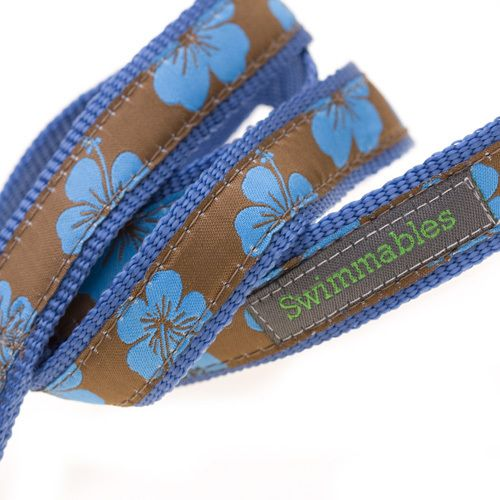 The Hamish McBeth swimmables leashes are ideal for walks on the beach, or on rainy days. These leashes are sturdy and made to last, because only good quality materials won't fray or break at the first sign of tension. The clip and spring are both rustproof, and the bold, bright design matches the same collar in the swimmables range. Blue hibiscus on brown background. #dogleash #doglead #leash #lead