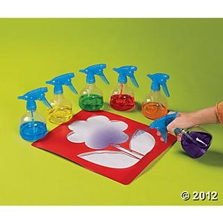 "Fill spray bottles with watered down paint & use muscles to spray a mist over a stencil ("",)"