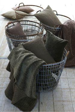 vintage metal baskets for blanket/pillow storage.