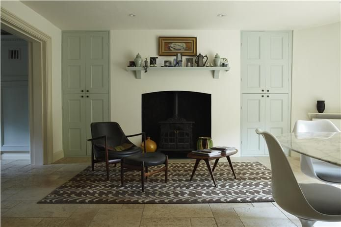 Beautiful furniture amid a room decorated in Farrow and Ball 'All White', 'Pointing' and 'Theresa's Green'.