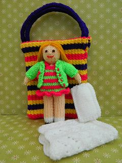 This is Bella in a Bag. She is a knitted doll and is 18cm tall. Everything she needs is in her bag! This pattern is worked flat & would suit beginners. http://www.ravelry.com/patterns/library/bella-doll-in-a-bag