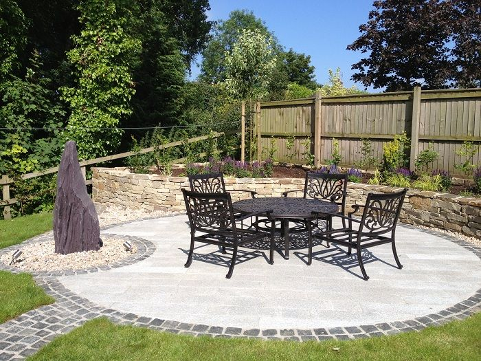 this large circular patio is perfect to catch the evening sun paving is marshalls - Garden Design Cheshire