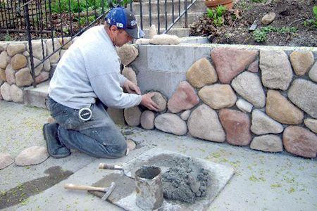 cobblestone and stucco homes | Masonry touches to your home's exterior, such as a retaining wall, can ...